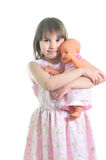 Little cute girl with doll. Isolated on the white background Stock Photo