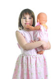 Little cute girl with doll. Isolated on the white background Royalty Free Stock Images