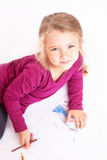 Little cute girl draws pencils sitting on the floor Royalty Free Stock Image