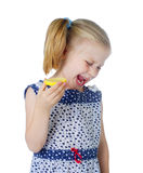 Little cute girl eating fresh lemon Royalty Free Stock Photography