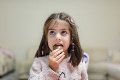 Little cute girl eats surprise chocolate stock photography