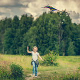 Little cute girl flying a kite Royalty Free Stock Images
