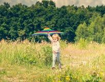 Little cute girl flying a kite Stock Photo