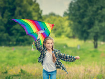 Little cute girl flying a kite Royalty Free Stock Photo