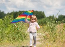 Little cute girl flying a kite Stock Image