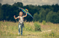 Little cute girl flying a kite Royalty Free Stock Photos