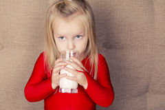 Little cute  girl with glass of milk Royalty Free Stock Images
