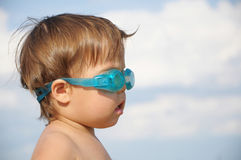 Little cute girl with goggles Stock Photos