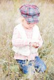 Little cute girl is going to hand the seeds Stock Photography