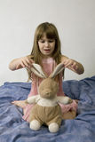 Little cute girl with hare Royalty Free Stock Image