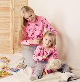 Little cute girl having fun with her mom stock photos