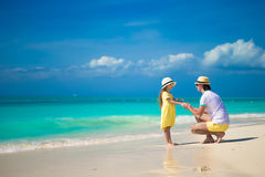 Little cute girl and her father on tropical exotic beach Royalty Free Stock Photos