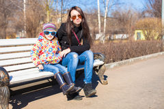 Little cute girl with her mother on sunny day outdoors Royalty Free Stock Photography