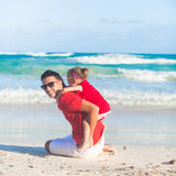 Little cute girl and her young father having fun Stock Photography