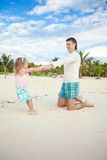 Little cute girl and her young father having fun Royalty Free Stock Photos