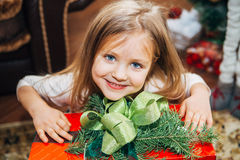 Little cute girl holding a Christmas gift Royalty Free Stock Photo