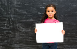 Little cute girl holding an empty paper sheet Stock Images