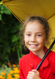 Little cute girl holding an umbrella Stock Photos