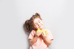 The little cute girl holds in hands apples Royalty Free Stock Photography