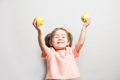 The little cute girl holds in hands apples Stock Photography