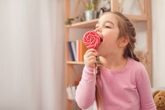 Little cute girl at home celebration concept eating lollipop royalty free stock photos