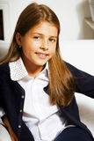 Little cute girl at home smiling. Casual look for school royalty free stock photo