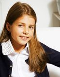 Little cute girl at home smiling. Casual look for school royalty free stock photos