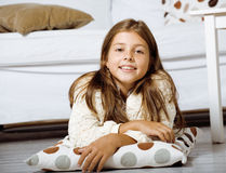 Little cute girl at home smiling. Laying on the floor royalty free stock photos