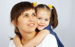 Little cute girl hugging her mother Royalty Free Stock Photography