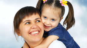 Little cute girl hugging her mother Royalty Free Stock Images