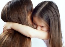 Little cute girl hugging her mother's neck Stock Photography