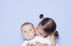 Little cute girl hugging little baby brother royalty free stock photos