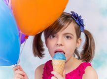 Little cute girl with ice cream Stock Images