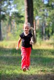 Little cute girl jogging in forest Stock Photo