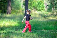 Little cute girl jogging in forest Royalty Free Stock Photos