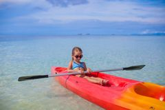 Little cute girl kayaking in the clear blue sea Stock Image