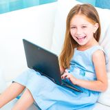 Little cute girl with a laptop Stock Image