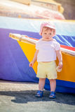 Little cute girl leaning on a boat royalty free stock images
