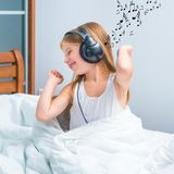 Little cute girl listening to music Royalty Free Stock Photography