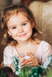 Little cute girl looking at camera and smiling Royalty Free Stock Images