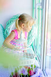 Little cute girl looking out window Stock Photography