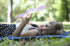Little cute girl lying on the grass and rests Royalty Free Stock Image
