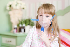 Little cute girl makes inhalation home Stock Photo