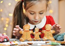 Free Little Cute Girl Makes Traditional Gingerbread Man. Stock Photos - 168070733