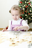 Little cute girl making cookies Royalty Free Stock Images