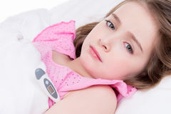Little cute girl measures the temperature. Royalty Free Stock Photography