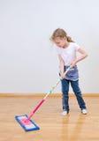 Little Cute Girl Mopping Floor. Stock Photos