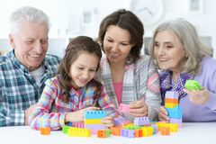 Little cute girl with mother and grandparents playing  together Royalty Free Stock Photos