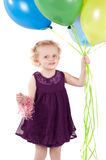 Little cute girl with multicolored air balloons Stock Photo