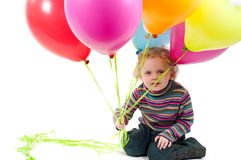 Little cute girl with multicolored air balloons Stock Images